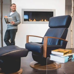 Dutalier modern glider chair in black leather with matching gliding ottoman handcrafted in Canada