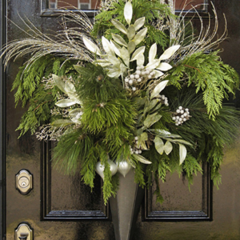 Elegant front door handmade Christmas wreath with white and silver decorative accents