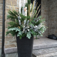 Large decorative outdoor winter planter with evergreen and brich branches to accent your home