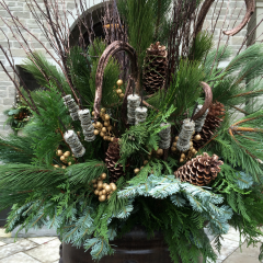 Gorgeous winter-themed planter with large pine cones