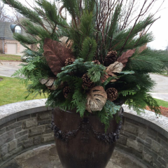 Large fall urn planter with evergreens, faux leaves and pine cones