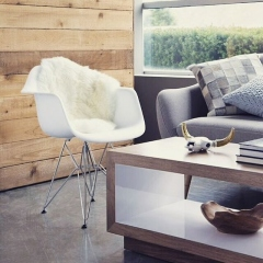 Living room decor with white eiffel chair and modern wooden coffee table