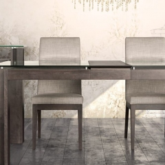 Verbois extendable solid wood dining table with upholstered chairs available at Not Just for the Garden