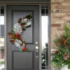 Handmade Christmas door arrangement with bright faux foliage