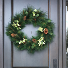 Modern wreath with pine cones and white accents, perfect to display all year round