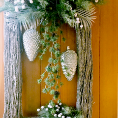 Personalized Christmas door arrangment in a rectangular shape that frames the decorative elements inside